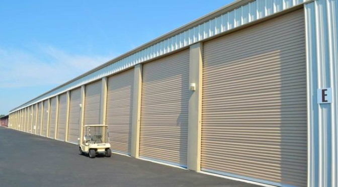 A row of large, outdoor storage units in a clean environment