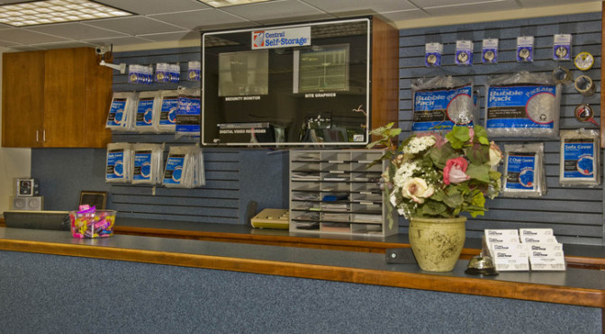 Facility office overlooking the front desk with moving and packing supplies available