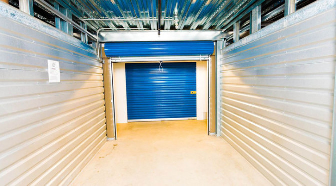 View inside a large, clean storage unit with no belongings