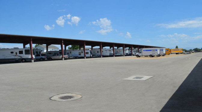 A large outdoor RV, car, and truck parking lot