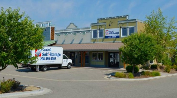 Street view of Central Self Storage facility with moving truck parked in front of entrance