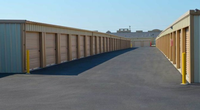 A row of clean outdoor storage units with light orange doors